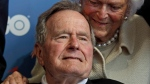 Former President George H.W. Bush and his wife, Barbara, arrive for the premiere of HBO's new documentary about his life in Kennebunkport, Maine, June 12, 2012. (AP / Charles Krupa)