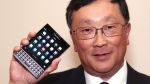 BlackBerry CEO John Chen shows off the new Passport phone after the company's Annual General Meeting in Waterloo, Ont., Thursday June 19, 2014. (THE CANADIAN PRESS / Dave Chidley)