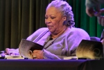 Author Toni Morrison signs copies of her latest book 'Home,' during Google's online program series, 'Authors At Google' in New York on Feb. 27, 2013. (AP / Bebeto Matthews)