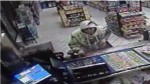 Barrie police released this surveillance photo on Wednesday, May 27, 2015 of a suspect wanted in connection to a knife-point robbery in Barrie, Ont. (Barrie Police Service)