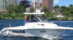 Officers can be seen on an OPP patrol boat on Lake Simcoe in Barrie, Ont. on Friday, June 26, 2015. (Heather Butts/ CTV Barrie)