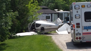 Two people suffered minor injuries after a small plane crashed west of Orangeville on Friday July 3, 2015. (Courtesy: Carl Boone)