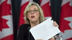 Green Leader Elizabeth May holds up a draft agreement as she speaks about the upcoming Paris climate conference during a briefing, Thursday, November 19, 2015 in Ottawa. (Adrian Wyld/THE CANADIAN PRESS)