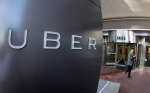 A man leaves the headquarters of Uber in San Francisco in this Dec. 16, 2014, file photo. (THE CANADIAN PRESS/AP-Eric Risberg)