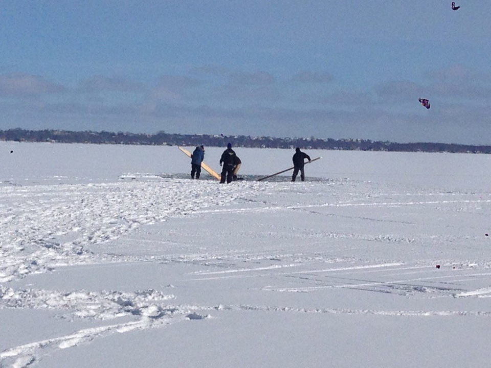 People try to remove a snowmobile that fell through the ice of Lake Simcoe on Monday, Jan. 18, 2016. (Rob Cooper/ CTV Barrie)