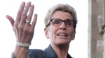 Ontario Premier Kathleen Wynne speaks to reporters as she arrives at the First Ministers meeting at the Canadian Museum of Nature in Ottawa on Monday, Nov. 23, 2015. (Sean Kilpatrick/THE CANADIAN PRESS)