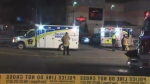 Paramedics arrive at the scene of a double stabbing in Vaughan that left one man dead and another seriously injured.