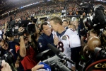 Denver Broncos' Peyton Manning, right, and Broncos' head coach Gary Kubiak celebrate after their win against the Carolina Panthers in the NFL Super Bowl 50 football game Sunday, Feb. 7, 2016, in Santa Clara, Calif. The Broncos won 24-10. (AP Photo/Julio Cortez)