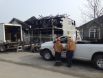 Crews can be seen outside of a home in Collingwood, Ont. on Monday, Feb. 8, 2016, following a fire one day earlier. (Brandon Rowe/ CTV Barrie)