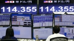 Money traders work in front of the computer terminal at a foreign exchange brokerage in Tokyo, Tuesday, Feb. 9, 2016. (AP / Shizuo Kambayashi)