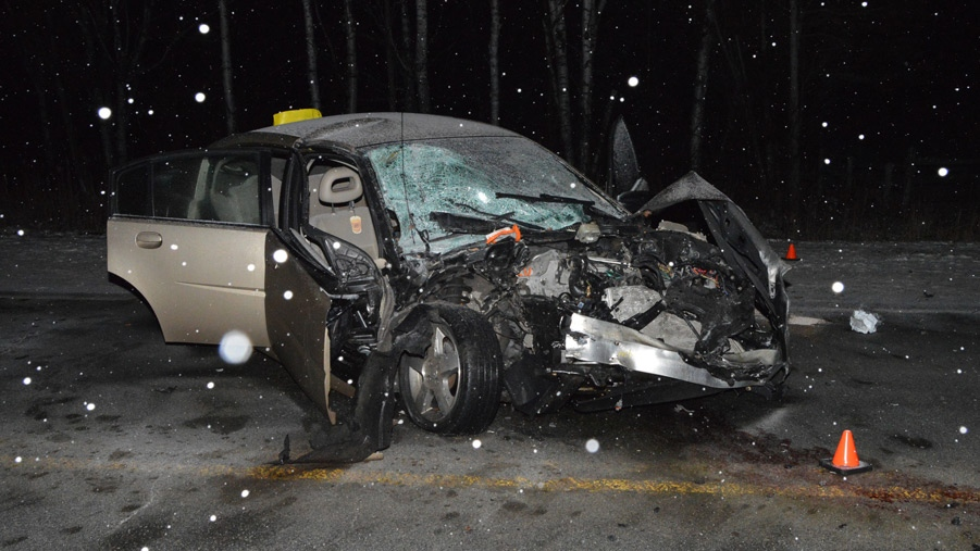 A damaged car is seen after a crash with an ambulance in Innisfil on Tuesday, Feb. 9, 2016. (