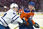 Toronto Maple Leafs' Morgan Rielly (44) battles for the puck with Edmonton Oilers' Connor McDavid (97) during first period NHL action in Edmonton, Alta., on Thursday February 11, 2016. (Jason Franson / THE CANADIAN PRESS)
