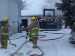 Fire crews can be seen at a garage fire in Stroud, Ont. on Saturday, Feb. 13, 2016. (Dave Erskine/ CTV Barrie)