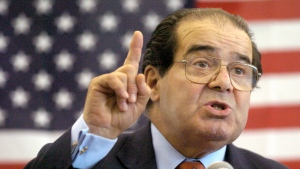 In this Wednesday, April 7, 2004 file photo, U.S. Supreme Court Justice Antonin Scalia speaks to Presbyterian Christian High School students in Hattiesburg, Miss. On Saturday, Feb. 13, 2016, the U.S. Marshals Service confirmed that Scalia has died at the age of 79. (Gavin Averill / The Hattiesburg American via AP)