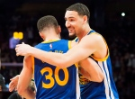 Golden State Warriors guard Klay Thompson (11) hugs Golden State Warriors guard Stephen Curry (30) after winning the three point competition during the NBA all-star skills competition in Toronto on Saturday, Feb, 13, 2016. (Mark Blinch / THE CANADIAN PRESS)