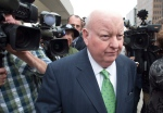 Sen. Mike Duffy walks past the cameras as he leaves the courthouse after being acquitted on all charges, Thursday, April 21, 2016 in Ottawa. THE CANADIAN PRESS/Adrian Wyld