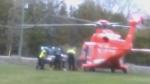 An air ambulance prepares to transport a man critically injured in a collision in Georgina Sunday April 24, 2016. (@kanarellisxo /Twitter)