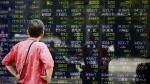 A man looks at an electronic stock indicator of a securities firm in Tokyo, Monday, May 2, 2016. (AP / Shizuo Kambayashi)