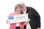 Patricia Richardson and Norman Sharp collect their winnings in this undated photo taken in Toronto, Ont. (OLG)