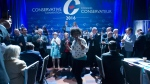 Conservative delegate Kenny Daodu dances during the closing ceremonies at the Conservative Party of Canada convention in Vancouver, Saturday, May 28, 2016. (Jonathan Hayward / THE CANADIAN PRESS)