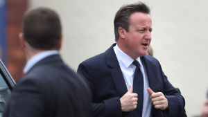 Prime Minister David Cameron arrives to watch a parade during Armed Forces Day at Cleethorpes, England, Saturday June 25, 2016. An online petition seeking a second referendum on Britain's exit from the European Union has already prompted more than 1 million names, a sign of the extraordinary reaction following Thursday's referendum vote to leave the 28-nation bloc. (Peter Byrne / AP)