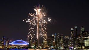 Fireworks explode from the CN Tower over downtown Toronto during the closing ceremonies of the Pan Am Games, Sunday, July 26, 2015. (AP Photo / Rebecca Blackwell)