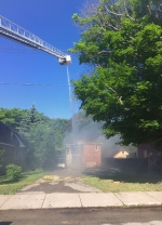 Firefighters use an aerial truck to extinguish a blaze at an abandoned house in Owen Sound, Ont. on Monday, June 27, 2016. (Roger Klein/ CTV Barrie)