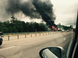 A tractor trailer erupted in flames on Highway 400 in Barrie, Ont. on Tuesday, June 28, 2016. (Jay Kraft/ MyNews)