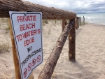 "A sign reading ""Private beach to water's edge. No Trespassing"" at a property on Balm Beach in Tiny Township, Ont. on Friday, July 15, 2016. (K.C. Colby/ CTV Barrie)"