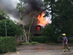 Flames destroy a home in Innisfil, Ont. on while firefighters work to put it out on Thursday, July 21, 2016. (Aileen Doyle/ CTV Barrie)
