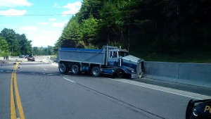 One person was seriously injured in a head-on crash involving a dump truck and a SUV on Highway 9 in Caledon, Ont. on Friday, July 22, 2016. (Ontario Provincial Police)
