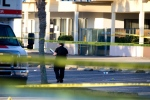 Police work among yellow evidence markers, at the scene of a deadly shooting outside of Club Blu in Fort Myers, Fla. Monday, July 25, 2016. Police said the gunfire, which erupted at a swimsuit-themed party for teens, was not an act of terrorism.(Luke Franke/Naples Daily News via AP)