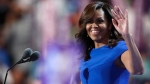 First Lady Michelle Obama takes the stage during the first day of the Democratic National Convention in Philadelphia , Monday, July 25, 2016. (AP Photo/Paul Sancya)