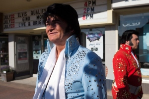 Elvis tribute artists Gordie McNeil, left, of Fort Erie, Ont., and William Young, of Bellville, Ont., stand outside the Gayety Theatre as they wait to compete in qualifying rounds at the Collingwood Elvis Festival in Collingwood, Ont., on Friday, July 22, 2016. (The Canadian Press / Chris Young)