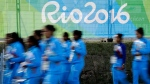 Members of the Indian women's field hockey team walk through the Olympic athletes village in Rio de Janeiro, Brazil, Saturday, July 30, 2016. The 2016 summer olympic games are scheduled to open Aug 5. (AP Photo/Charlie Riedel)