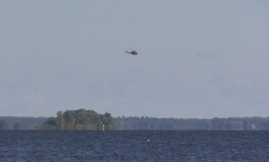 A helicopter flies above Georgian Bay, near Midland, Ont. as part of a search and rescue operation on Tuesday, Aug. 23, 2016. (Roger Klein CTV Barrie)
