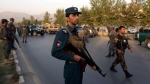 Afghan security forces stand guard after an attack on the American University of Afghanistan in Kabul, Afghanistan, Thursday, Aug. 25, 2016.  (AP /Rahmat Gul)