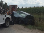 A car is seen being pulled out of a cornfield in Springwater Ont,. after a collision sent three people to hospital (Steve Mansbridge CTV Barrie)