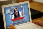 A student tests her laptop's webcam in Farmingdale, Maine, on Sept. 3, 2009. (AP / Robert F. Bukaty)