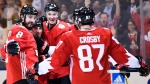 Team Canada's Brad Marchand (63), centre left, celebrates his goal against Team Russia with teammates Drew Doughty (8), Team Canada's D Jay Bouwmeester (4) and Sidney Crosby (87) during third period World Cup of Hockey semifinal action in Toronto on Saturday, September 24, 2016. (THE CANADIAN PRESS / Nathan Denette)