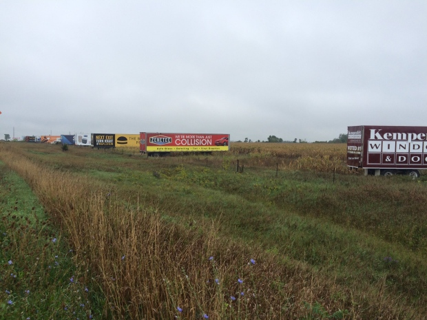 Trailer signs can be seen along a stretch of Highway 400 in Barrie, Ont. on Monday, Sept. 26, 2016. (Heather Butts/ CTV Barrie)