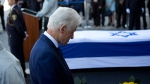 Former U.S. President Bill Clinton pays respect next to the coffin of former Israeli President Shimon Peres at the Knesset plaza in Jerusalem, Thursday, Sept. 29, 2016 (AP Photo/Ariel Schalit)