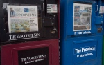 Newspaper boxes containing the Vancouver Sun and the Province are seen in downtown Vancouver, Tuesday, Jan. 19, 2016. (Jonathan Hayward / THE CANADIAN PRESS)