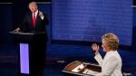 Democratic presidential nominee Hillary Clinton debates with Republican presidential nominee Donald Trump during the third presidential debate at UNLV in Las Vegas, Wednesday, Oct. 19, 2016. (Mark Ralston/Pool via AP)