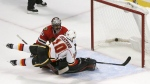 Calgary Flames' Kris Versteeg (10) scores the winning goal past Chicago Blackhawks goalie Corey Crawford during the sudden-death shootout period of an NHL hockey game, Monday, Oct. 24, 2016, in Chicago. The Flames won 3-2. (AP / Charles Rex Arbogast)