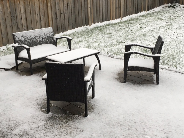 Snowfall covered outdoor furniture in Barrie, Ont. on Thursday, Oct. 27, 2016. (Katherine Ward/ Twitter)