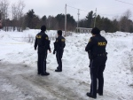 OPP officers can be seen in McDougall Township, Ont. on Monday, Jan. 16, 2017 after human remains were found. (Rob Cooper/ CTV Barrie)