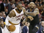 Cleveland Cavaliers' LeBron James, left, drives against Phoenix Suns' P.J. Tucker in the second half of an NBA basketball game in Cleveland, Thursday, Jan. 19, 2017. (AP / Tony Dejak)