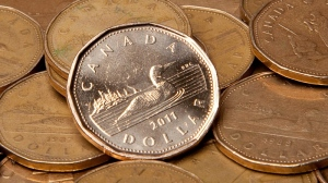 The Canadian dollar was down about two-thirds of a US cent Wednesday as the Bank of Canada said it was keeping its key rate unchanged at one per cent amid expectations of weaker than expected economic growth. (Jonathan Hayward / THE CANADIAN PRESS)